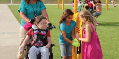 Child in wheelchair playing